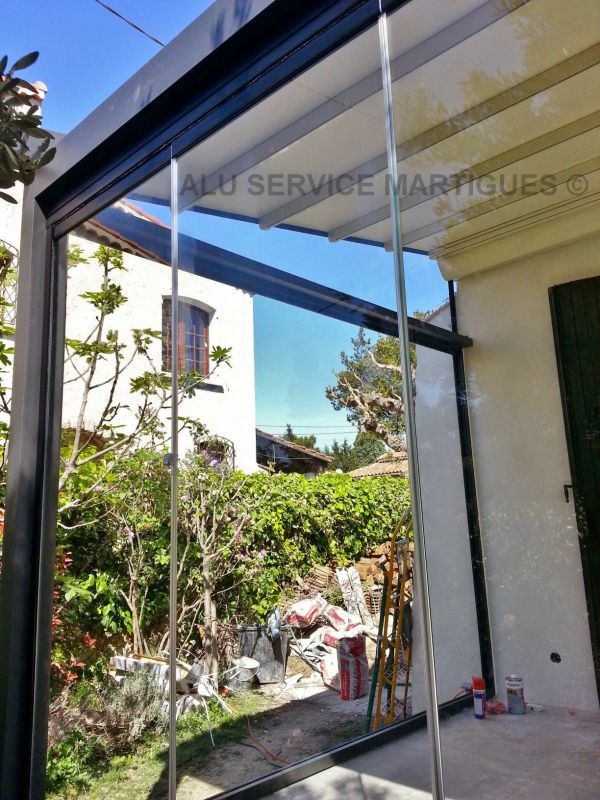cloisons de verre repliables panoramiques sur port de bouc. Black Bedroom Furniture Sets. Home Design Ideas
